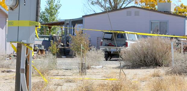 Crime scene tape still surrounds a home on East Third Street in Silver Springs on Monday after two bodies were discovered by local authorities on Saturday night.