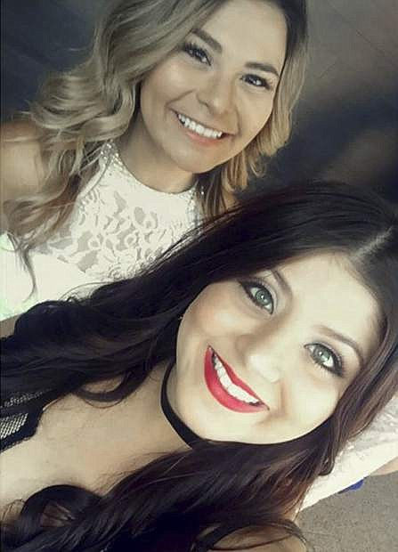 This photo provided by Marissa Nino shows a spring, 2017 self-portrait by her cousin Karessa Royce, 22, lower right, and her friend Pam Rios in Las Vegas. When Royce was wounded in the mass shooting in Las Vegas Sunday, Oct. 1, 2017, Rios rushed her to an ambulance which took her to a hospital. She was shot in the shoulder and is in intensive care following surgery for a collapsed lung, but is expected to survive. (Marissa Nino/Karessa Royce via AP)