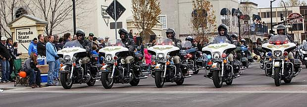 Carson City Sheriff's Officers ride down newly remodeled Carson Street Saturday morning.