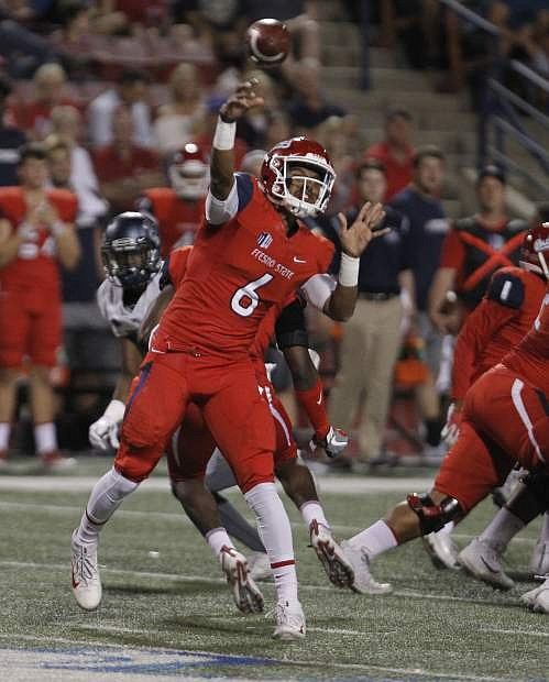 Fresno State's Marcus McMaryion drops back to pass against Nevada in the first half of an NCAA college football game in Fresno, Calif., Saturday, Sept. 30, 2017. (AP Photo/Gary Kazanjian)