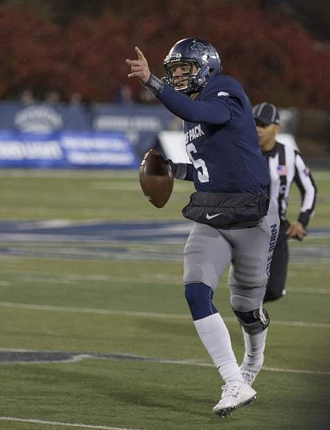 Nevada quarterback Ty Gangi scrambles during the first half of an NCAA college football game against Air Force in Reno, Nev., Friday, Oct. 20, 2017. (AP Photo/Tom R. Smedes)
