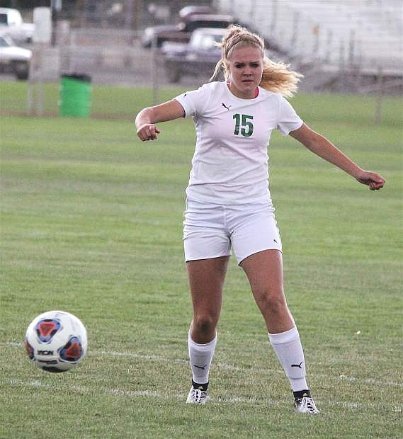 Chandler McAlexander prepares to kick the ball as it comes toward her.