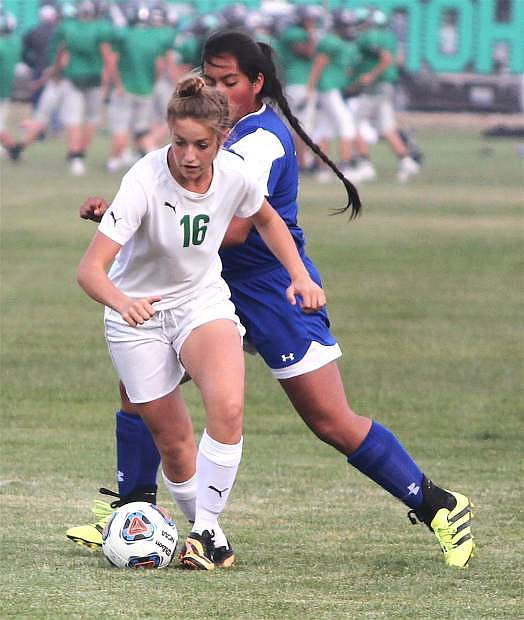 Aspen Mori evades one of Lowry's players at the CCHS soccer field.