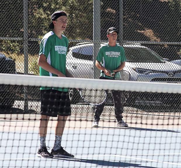 Blake Malkovich and Myles Getto, No. 2 doubles team for boys, prepare for the serve.