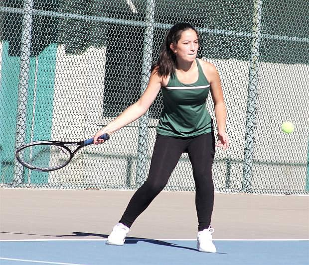 Ashby Trotter focuses as she returns the ball during her match in North Tahoe.