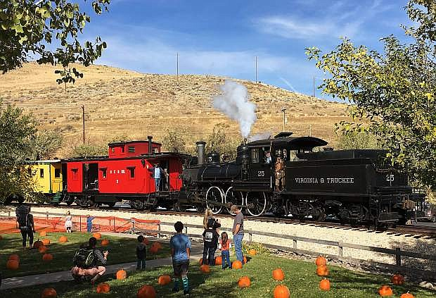The Nevada State Railroad Museum's steam locomotive No. 25 carries passengers while kids of all ages enjoy the pumpking patch during the 2016 Harvest Train event at the museum.