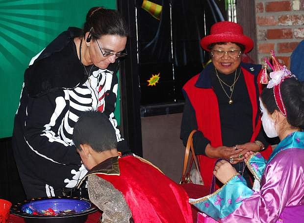 Merchants will give out candy and other goodies during Monday's eighth annual Spooktacular.