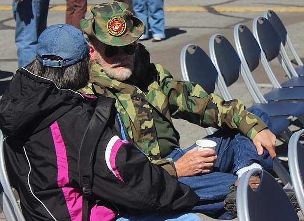 Ronald Coleman, right, who served in the U.S. Marine Corps during the Vietnam War, talks to a fellow veteran.