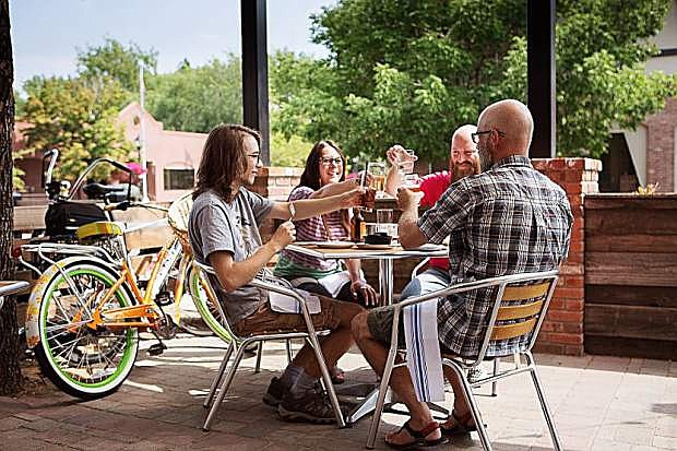 Jeff Moser (far right) toasts his family, son Charlie (left) and wife Kristy (center) with Randy Gaa (second from left) at The Union Eatery, Tap House and Coffee. The restaurant celebrates its Grand Opening with a community party benefitting the Boys & Girls Clubs of Western Nevada and The Greenhouse Project today from 5:30-8:30 p.m.