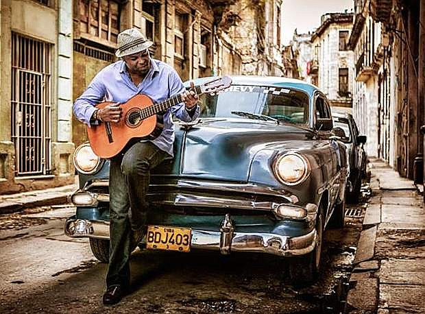 Adonis Puentes is a Grammy-nominated vocalist and composer from Cuba who weaves passionate, hypnotic Salsa and Son melodies through jazz arrangements.