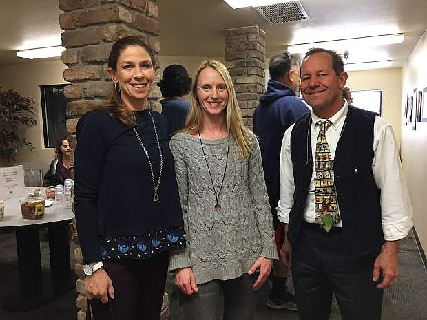 From left: Malaynia Wick, Kelley Yost, Michael Malley, some of the artists featured at the Community Development Building in Carson City.