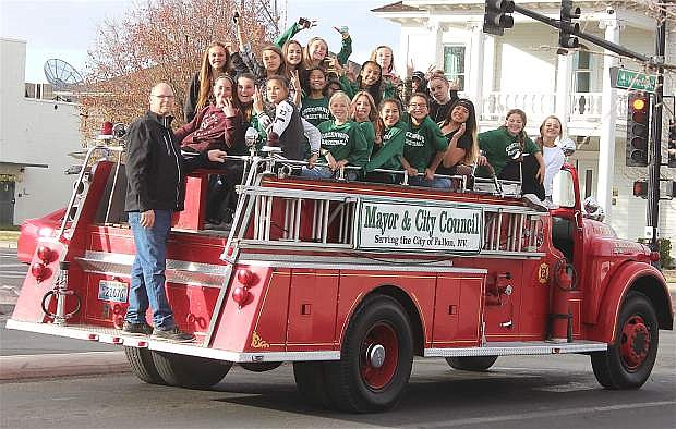 Churchill County Middle School's 7th-grade girls' basketball team rides through town after dying the Maine Street fountain green in celebration of their championship win in the Sagebrush League. Pictured in no order are Darci Owens, Liliona Bettencourt, Baley Skeen, Kambrie Thorn, Ramona Norris, Payton Smith, Lexi Freeman, Kaiserita Otuafi, Mattea Cortez, Kaitlynn Hoffman, Skai Shults and coach Keith Lund.