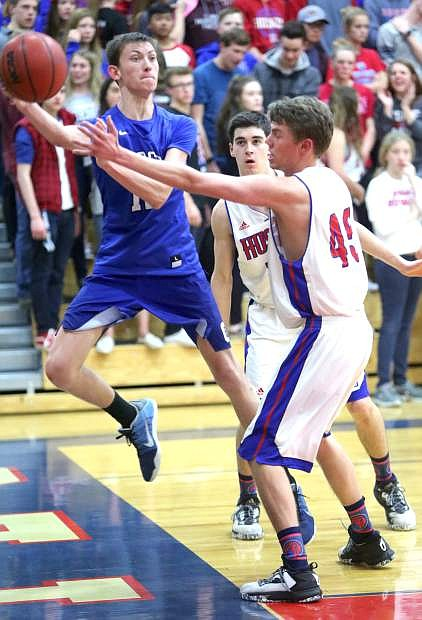 Trent Robison passes to a teammate before falling out of bounds in a playoff game against Reno last season.