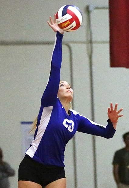 Carson's Ku'ulei Haupu serves during Thursday's match at Reno High School.