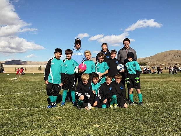 The AYSO Region 140 All-Star Team, back from left coaches Jerry, Kelley and Devon. Middle from left: David Del Fiorentino, Adam Doan, Liam Kenison, Andre Scanlon, Rowan Muoz and Kaiden Cook. Front from the left: Jaden Allec, Joel Delgado-Garcia, William Humphrey and Logan Riipi.