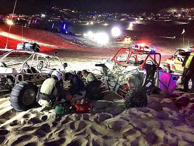 Bureau of Land Management law enforcement personnel attend to an injured UTV driver Friday night at Sand Mountain.