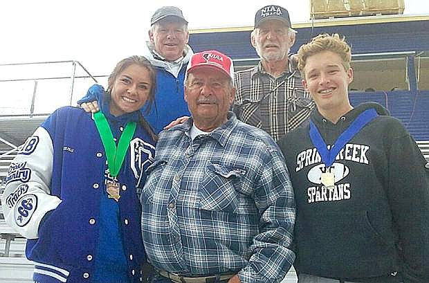 Front, from left, Rheanna Fallini-Jackson of Carson, grandfather Joe Fallini, and William Fallini-Haas of Spring Creek. In the back are Carson coach Pete Sinnott, left, and Ron Lee (Joe Fallini's Nevada high school running rival from the 1960s).