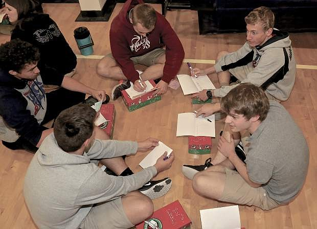 Sierra Lutheran students fill out Christmas cards as part of Operation Christmas Wednesday at the school.