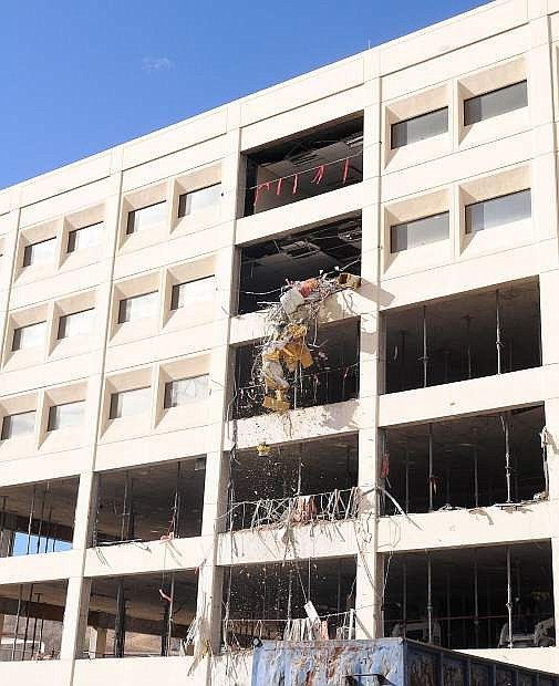Crews from Advance Installations and Las Vegas Demo worked through the Veterans Day holiday gutting the old Kinkead Building in preparation for tearing down the concrete and steel frame.