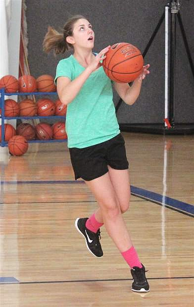 Emma Robinson goes in to shoot a basket during an Oasis Lady Bighorns basketball practice.