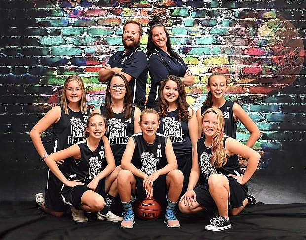 Oasis Academy's 8th grade team (left to right): Front row: Cassie Edgemon, Jaylee McEwen, Lainee Reid; Middle Row: Maiya Swan, Zoey Ligenfelter, Gabby Hockenberry-Grimes, Ellie Bird; Back Row: Coach Jake Lewis, Coach Loni Faught
