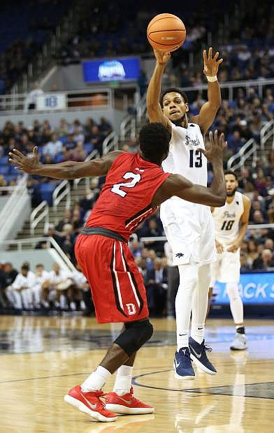 Nevada's Hallice Cooke passes against Davidson during Tuesday's victory in Reno.