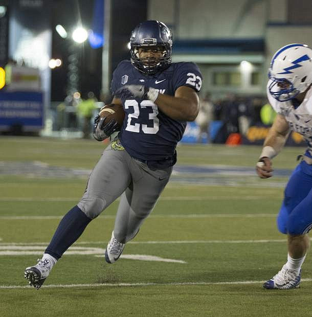 Nevada's Kelton Moore (23) runs against Air Force in the first half in Reno, Friday, Oct. 20.