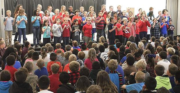 "Numa's 5th-grade choir sings ""This Land is Your Land"" for their classmates and guests during the Veterans' Day assembly."