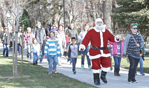Santa walks along the capital mall with a good sized group of people on their way to the Carson Mall last year in Carson City. The Carson Mall will again be offering its Chirstmas Fair.