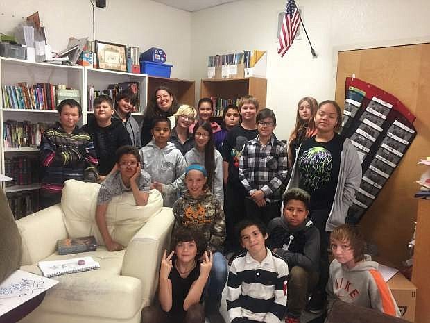Rachel Leach, back row, poses with her sixth-grade students at Silver Springs Middle school.