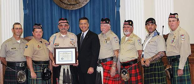 Gov. Brian Sandoval posed with the Scottish American Military Society Honor Guard post 1864 after they were recognized as Veteran Supporter of the Month.
