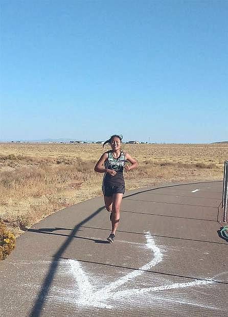 K Usuma Chompaeng runs the course in Sparks during the regional cross country race.