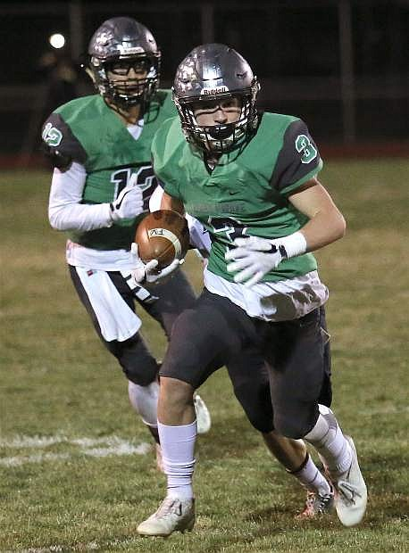 Fallon's Tommy McCormick runs down the sideline against Sparks on Friday.
