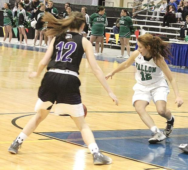 Alexis Jarrett, right, races Spring Creek's Delayanne Walz to grab the ball during last year's Northern 3A regional tournament.