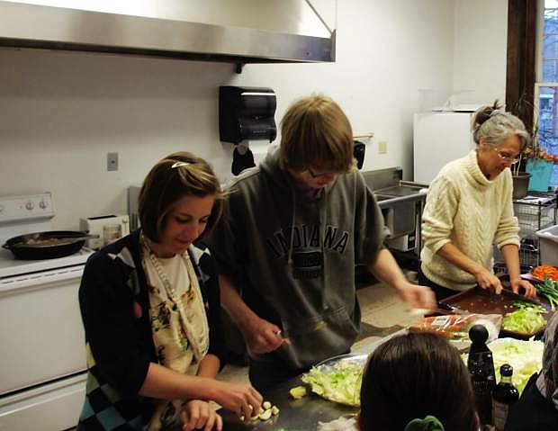 Healthy Communities hosts free cooking classes in Dayton every month. Pictured here, Rebekah Stetson, Mylo McCormick and dietitian Kim Mason demonstrate how to cook a nutritious dish.