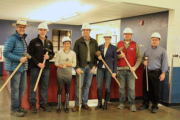 Boys and Girls Club board member and representatives from Lowes and Miles Contruction ready for the construction of the club's new front desk area.