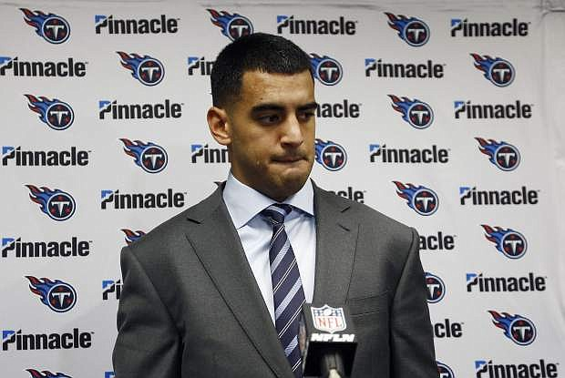 Tennessee Titans quarterback Marcus Mariota listens to a question during a news conference on Dec. 10.