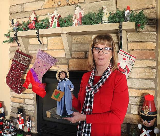 Sue Buckner, committee chair of the annual Christmas Home Tour, is showcasing her vintage caroler collection, which also will be featured during her tour Saturday.