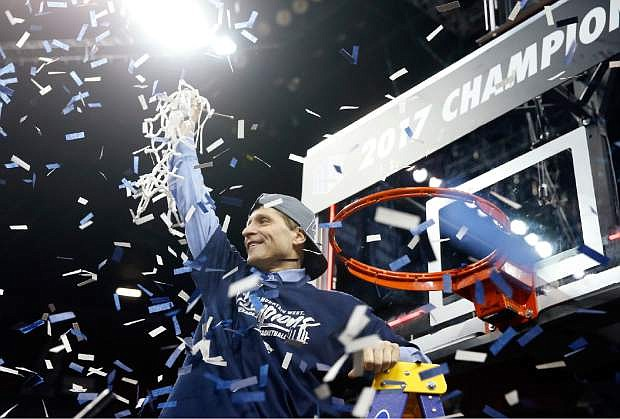 Nevada coach Eric Musselman cuts the net after Nevada defeated Colorado State 79-71 for the Mountain West Conference tournament championship last year in Las Vegas.