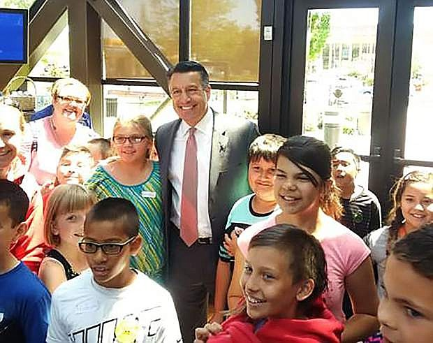 Nevada Gov. Brian Sandoval poses for a photo with 4th-grade students from Mark Twain Elementary School in Carson City in the Dema Guinn Concourse of the Nevada State Museum in this May 26, 2017 photo. The 2017 Nevada Legislature approved $500,000 in funding to reimburse school disctricts for the cost of transporting students on field trips to the seven state museums. Peter Barton/Nevada Division of Museums and History