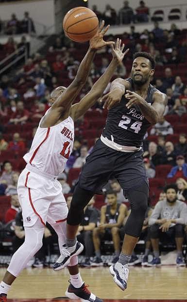 Nevada's Jordan Caroline passes off against Fresno State's Bryson Williams during the second half of an NCAA college basketball game in Fresno, Calif., Wednesday, Dec. 27, 2017. Nevada won 80-65. (AP Photo/Gary Kazanjian)