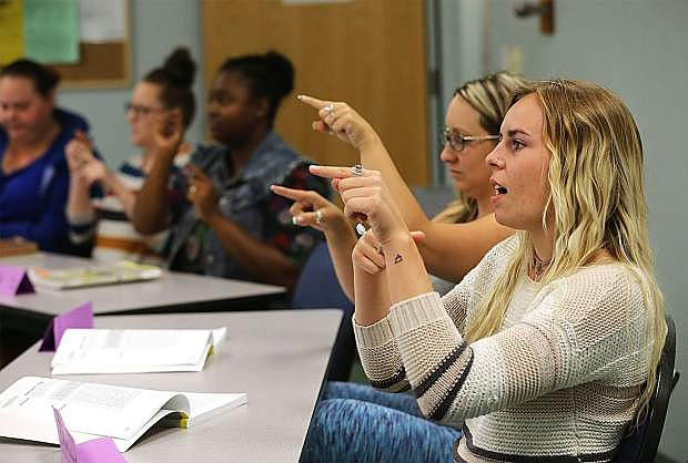 Rachael Seabert, right, and other students work in an American Sign Language class at Western Nevada College on Sept. 19.