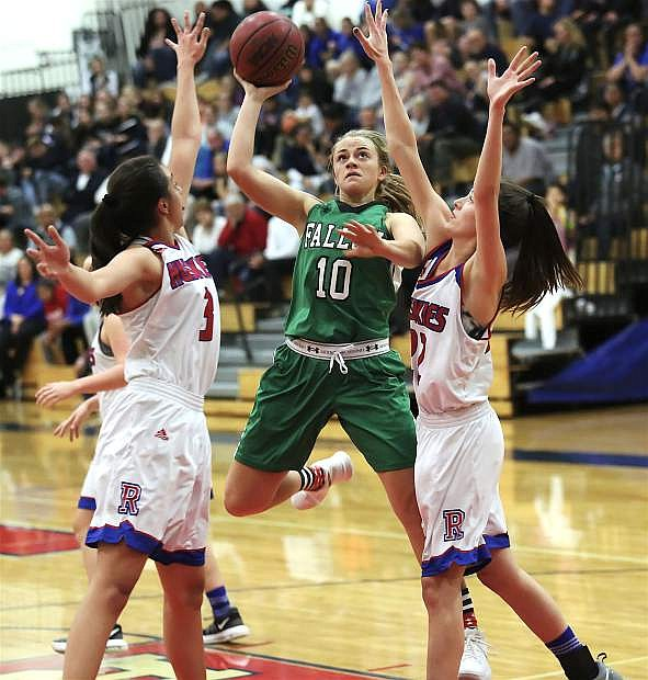 Fallon's Kaitlyn Hunter shoots between two Reno defenders in the Lady Wave's 43-39 loss to last year's 4A regional tournament runner-up.