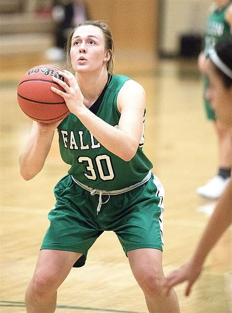 Faith Cornmesser lines up a shot during the Lady Wave's game against Bishop Manogue.