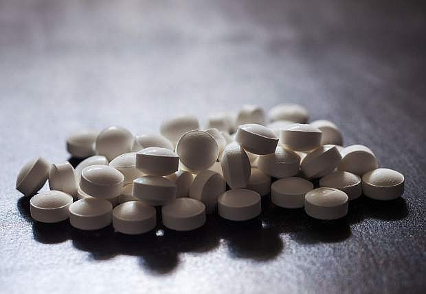 Nevada patients will be limited to a 14-day initial prescription for opioid pain medicines under a new law taking effect Jan. 1.
