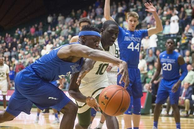 Colorado State forward Che Bob, right, and Air Force guard Pervis Louder fight for a loose ball in a game on Jan. 17 in Fort Collins, Colo.