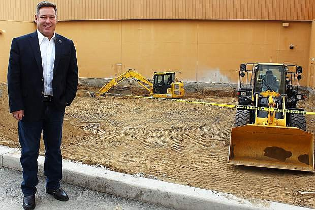Casino Fandango President and General Manager Court Cardinal stands in front of what now appears to be a big hole in the ground but will soon morph into a much-needed small convention center.