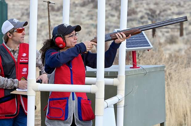 Team USA Development Department's Patsy Woods shoots her 'birds' under the watchful eye of USA team member Frank Thompson Thursday in Carson City.