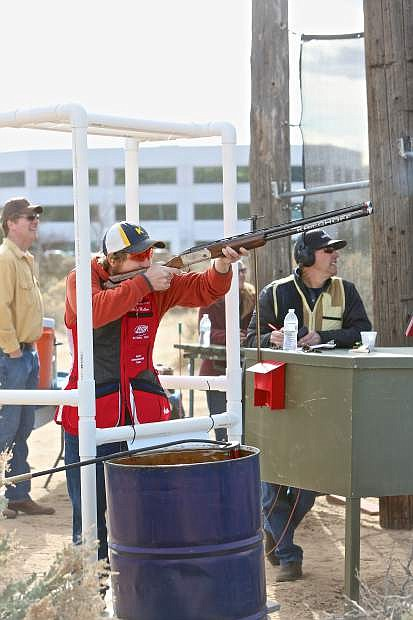 Five-time world champion team member Casey 'Jake' Wallace shoots his clay pigeons Thursday at the Capitol City Gun Club.