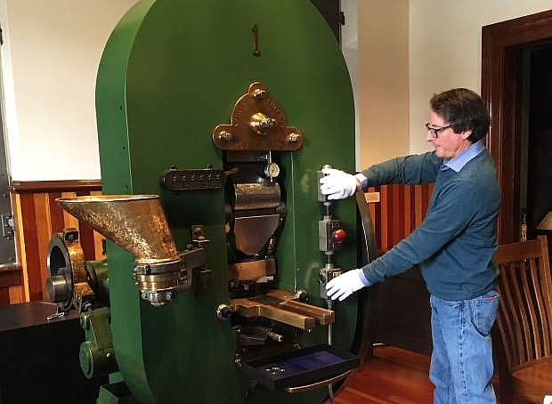 Nevada State Museum Director Myron Freedman operates Coin Press 1 during a demonstration in December. The museum will be holding monthly demonstrations the last Friday of each month.